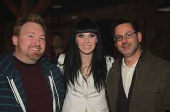 "Big Ride Entertainment artist Marlee Scott poses on the set of her ""Train Wreck"" music video with director Roman White (l) and CMT's Stephen Linn (r)."