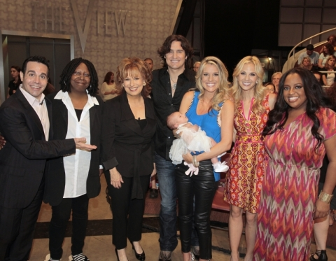 Pictured (l-r) are: guest host Mario Cantone, Whoopi Goldberg, Joy Behar, Joe, Heather and Dylan River Nichols, Elisabeth Hasselback and Sherri Shepherd Photo Credit: Lou Rocco/ABC