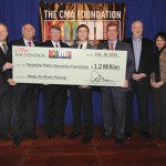 (l-r) CMA Board President, Ed Hardy; CMA Board Chairman, Troy Tomlinson; CMA Chief Executive Officer, Steve Moore; Director of Metropolitan Nashville Public Schools, Dr. Jesse Register; Scotty McCreery; Nashville Mayor Karl Dean; Chevrolet National Promotions Manager, Michael Weidman; Chair of The CMA Foundation Board of Directors, Kitty Moon Emery; and Nashville Public Education Foundation Board Chair, Michael Carter, Sr.  Photo Credit Donn Jones/CMA